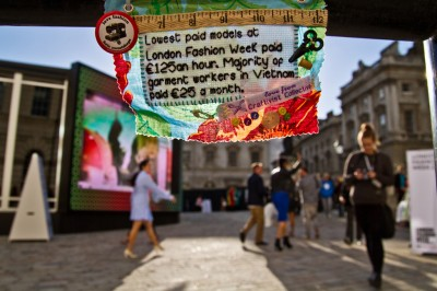 A mini protest banner hung inside the courtyard of Somerset House during London Fashion Week September 2012