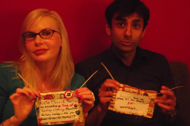 2 Craftivists at The Make Escape workshop with their #minifashionprotest banners