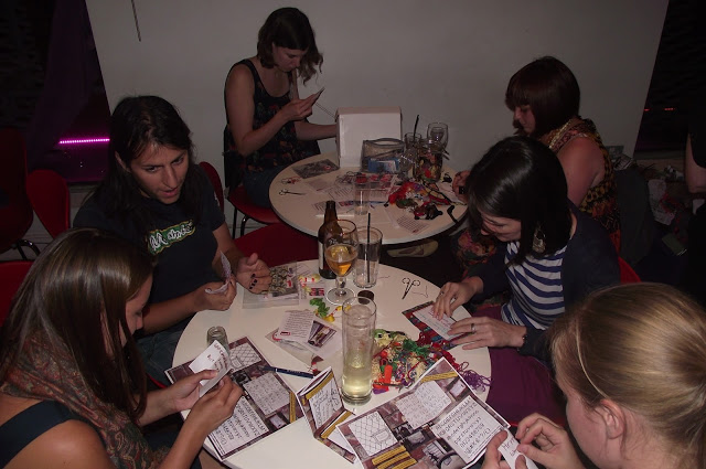 Craftivists at The Make Escape workshop - we had over 30 people stitching their #minifashionprotest banners that night!