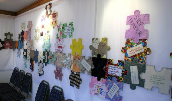 approx 300 of the 800 jigsaw pieces made from craftsers  around the UK displayed in Wolfson College, Oxford