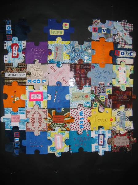 a collection of the fabric jigsaw pieces made by teachers and publics to add to the installation