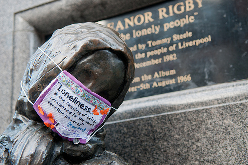 Mini Protest Mask on the statue of Eleanor Rigby, Liverpool. Image by www.markloudon.com