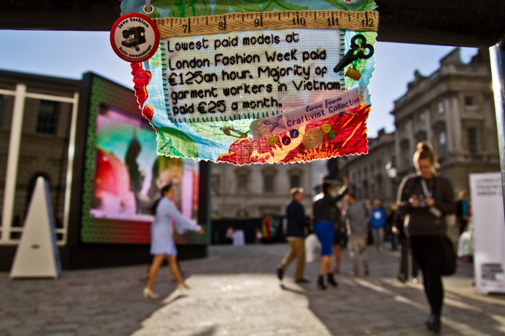 Mini Protest Banner inside Somerset House, London during London Fashion Week