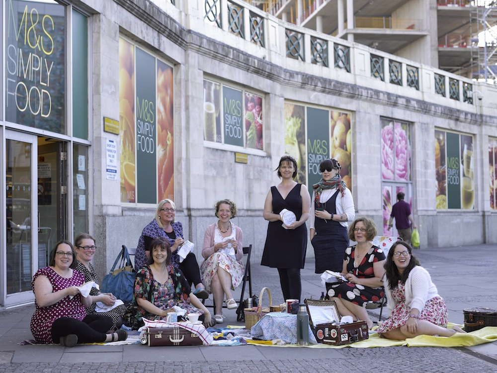 Craftivists in Cardiff at their stitch-in outside M&S SImply Food at the train station