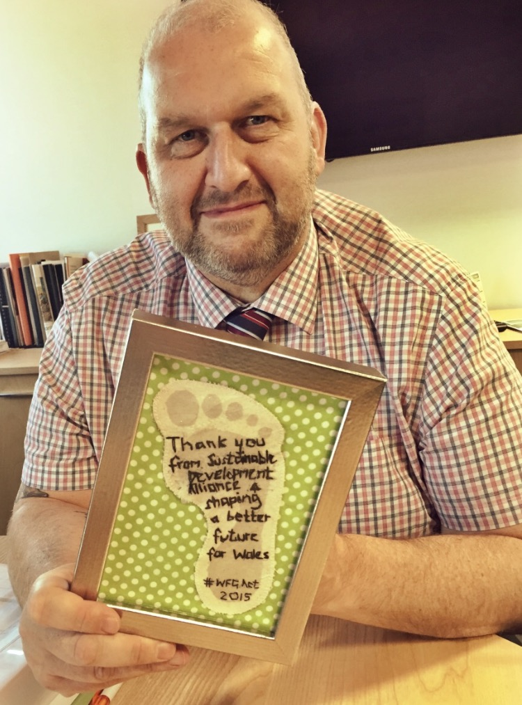 Carl Sargeant receives a thank you from Jess McQuade